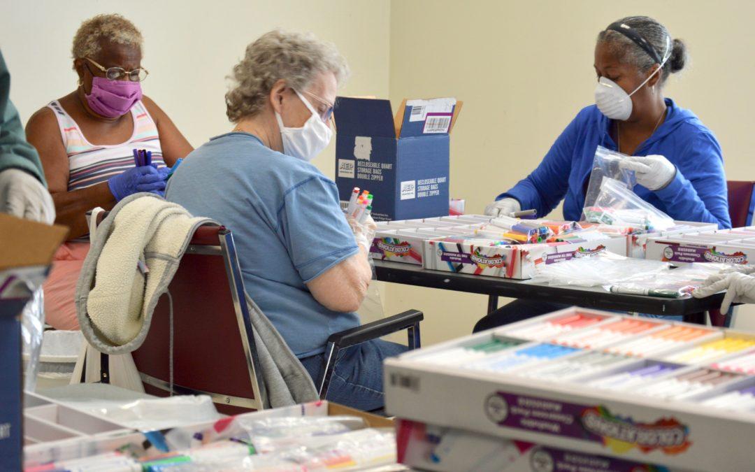 Volunteers Prepare New Bedford Students for School Year